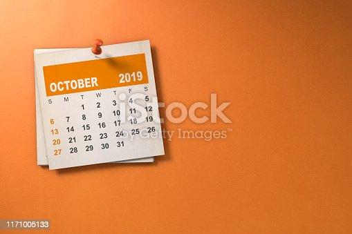 Halloween October 2019 calendar on orange background with copy space.