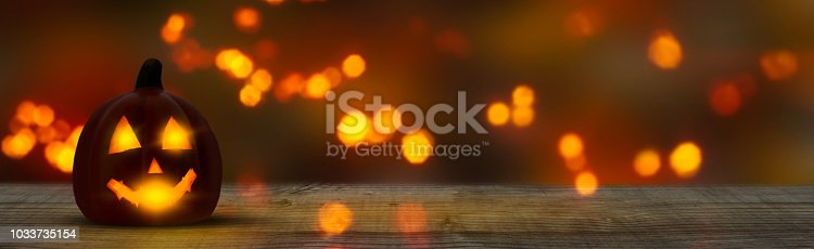 istock halloween panorama background with jack lantern and wooden table 1033735154