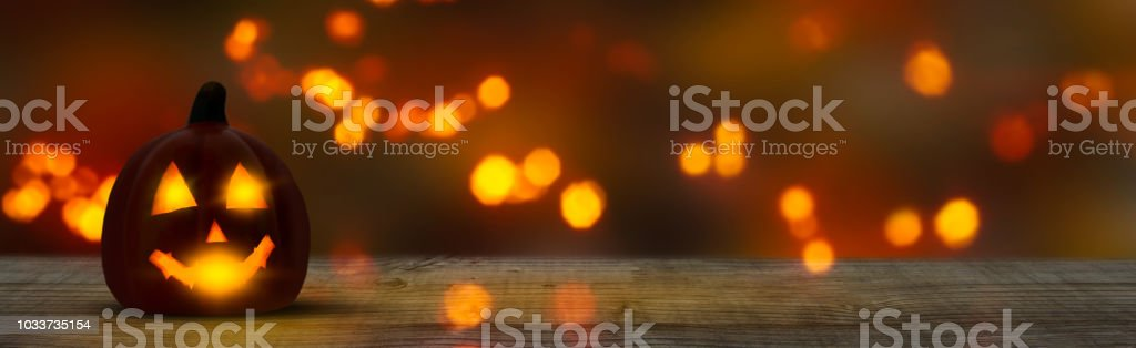 halloween panorama background with jack lantern and wooden table – zdjęcie