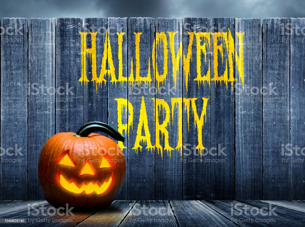 Halloween Party Advertised On Old Weathered Fence stock photo
