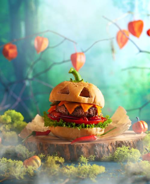 Halloween party burger in shape of scary pumpkin on natural wooden picture id1173186270?b=1&k=6&m=1173186270&s=612x612&w=0&h=ncuqqlc5nxxiwufmt1az6gujxlstds2tyfdvsfizdso=