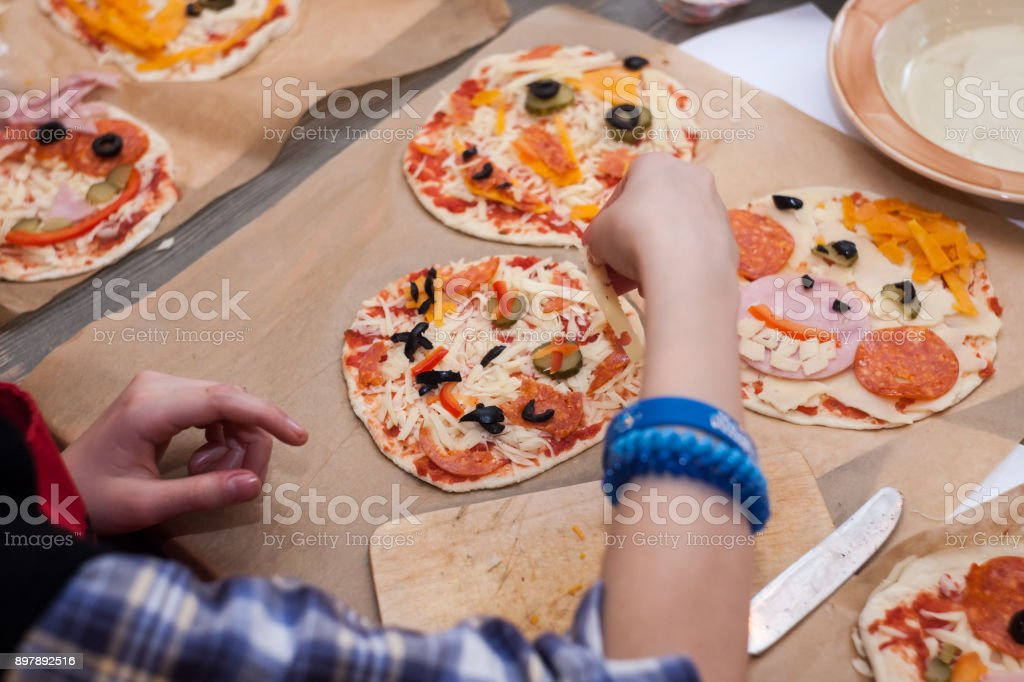 Halloween party ideas for kids ghost pizza with cheese and olives....
