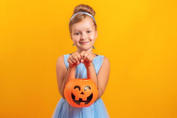 Halloween party little girl dressed as cinderella on a yellow a a picture id1167387283?b=1&k=6&m=1167387283&s=612x612&w=0&h=1wgsdhn2ksbnuwkuyz lixl ylexgg3foaeeuozgjee=