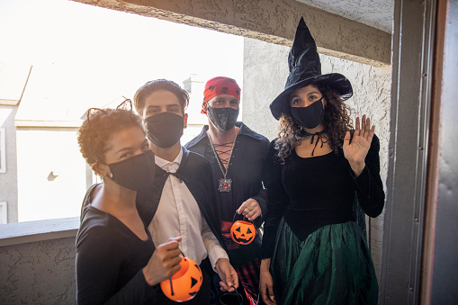 A group of friends celebrating Halloween during quarantine.