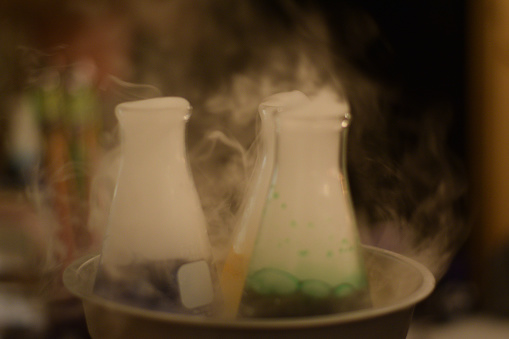 Halloween Party Punch With Dry Ice In Science Lab Beakers Stock