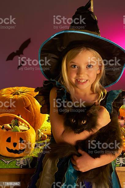 Halloween party with a child holding black cat in hand picture id178550562?b=1&k=6&m=178550562&s=612x612&h=dbhxigjjntqwfewr14nby11vs9 tbnvmvlpkfpqebza=