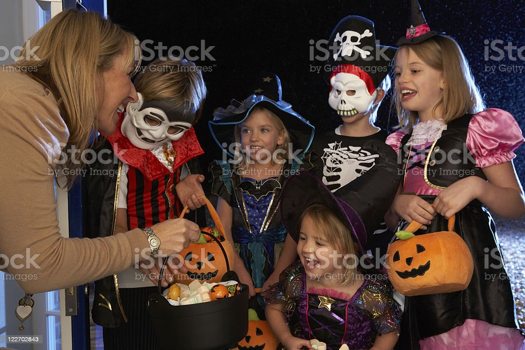 Halloween party with children trick or treating stock photo