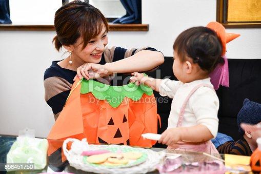 Mom and child are enjoying Halloween