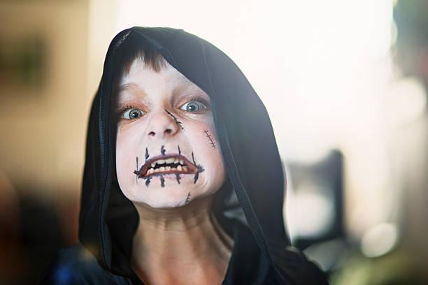 halloween portrait of a little boy dressed up as monster - kleine jungen kostüme stock-fotos und bilder