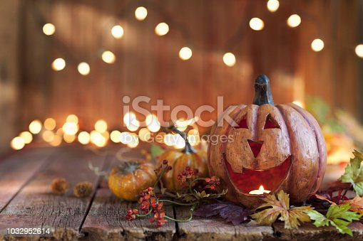 Halloween pumpkin arrangement with lights against an old rustic wood background