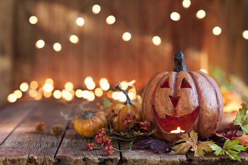 Halloween pumpkin arrangement with lights against an old rustic wood background
