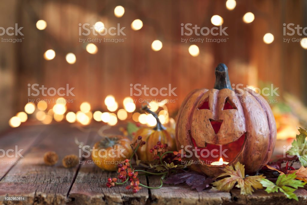Halloween Pumpkin against an old wood background stock photo