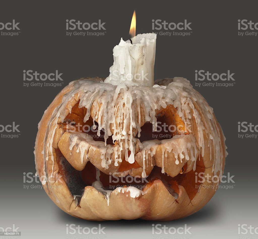 halloween pumpkin and candle on top royalty-free stock photo