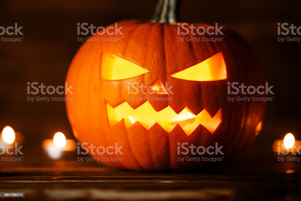 Halloween pumpkin and candles royalty-free stock photo