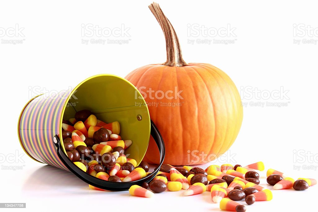 Halloween pumpkin and candy stock photo