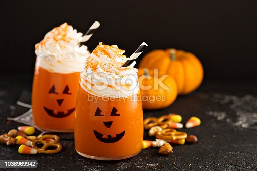 Halloween pumpkin cocktails topped with whipped cream