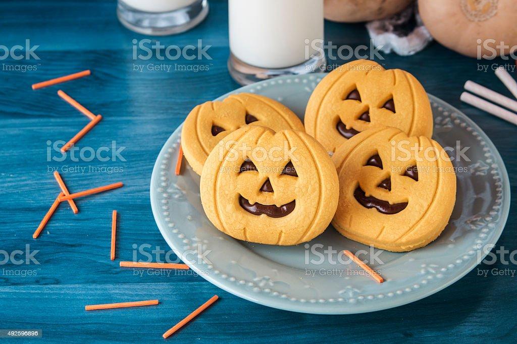 Halloween pumpkin cookies stock photo