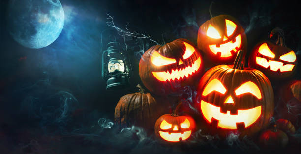 Halloween pumpkin head jack lantern with burning candles Halloween pumpkin head jack lantern with burning candles in scary deep night forest pumpkin stock pictures, royalty-free photos & images