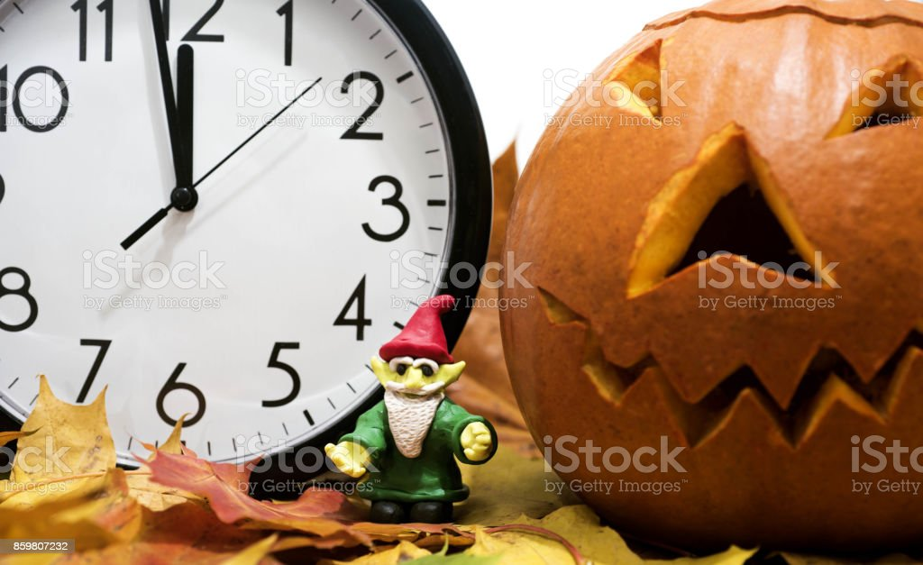 Halloween pumpkin head jack lantern with clock stock photo