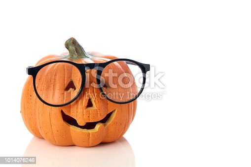 Carved smiling pumpkin Jack-o'-lantern with spectacles