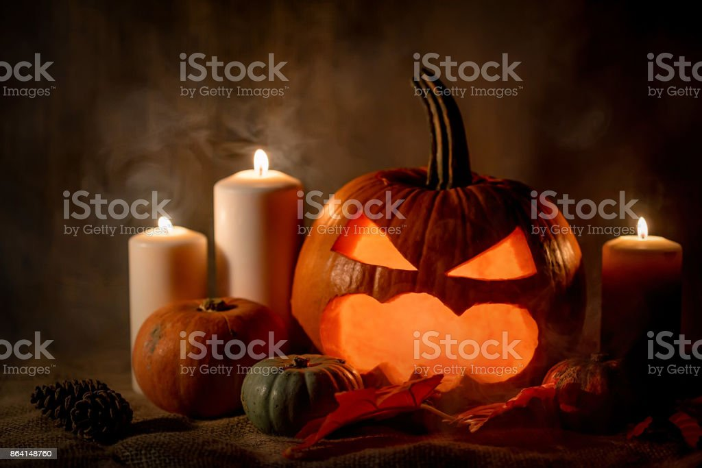 Halloween pumpkin head with burning candles royalty-free stock photo
