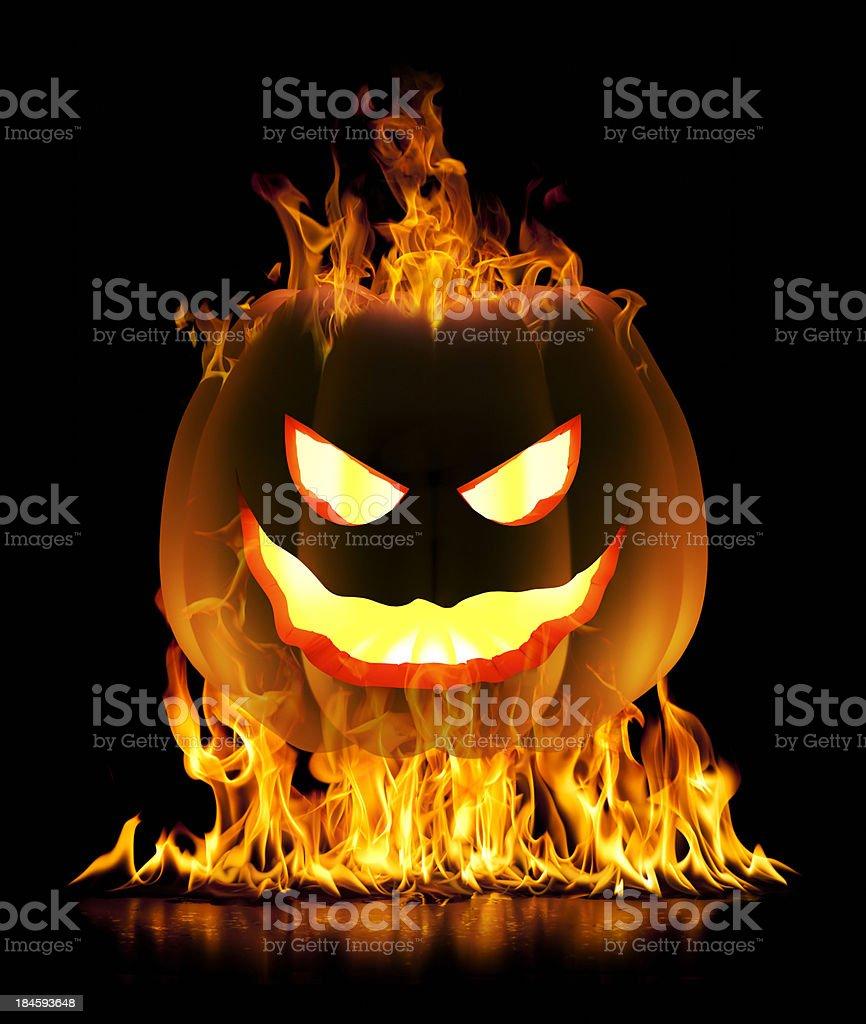 Halloween pumpkin in flames royalty-free stock photo