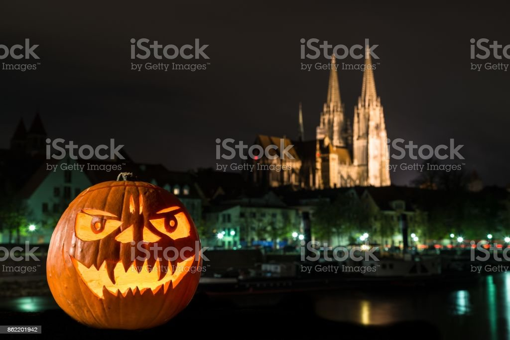 Halloween pumpkin in front of Cathedral and Danube river in germany, Germany stock photo