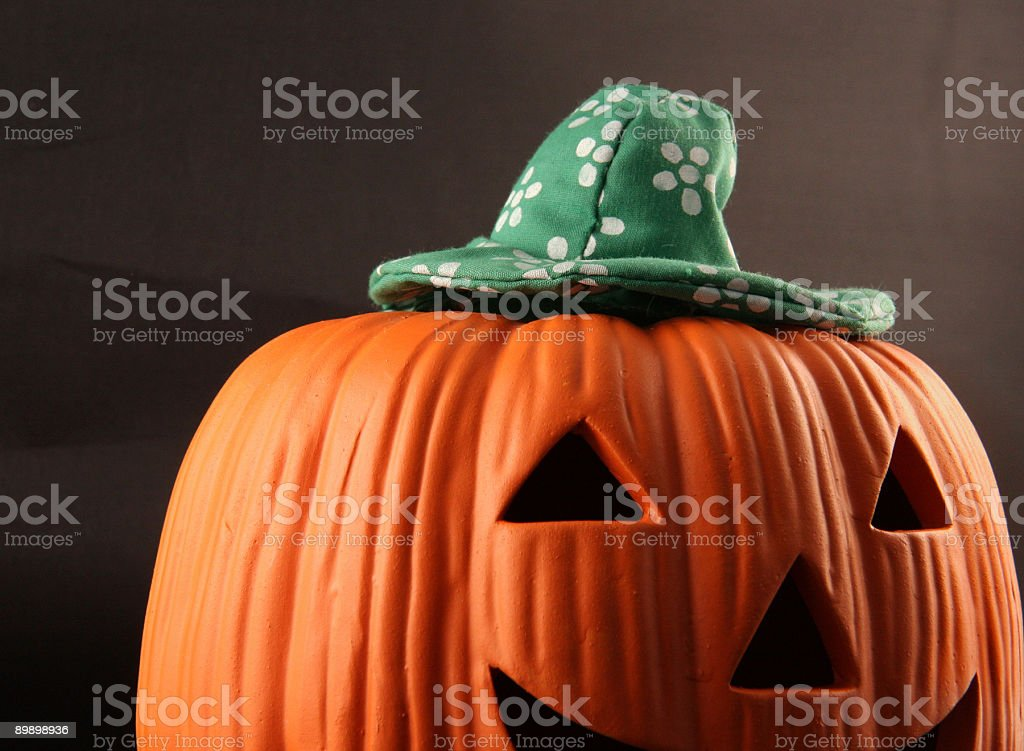 halloween pumpkin in green hat royalty-free stock photo