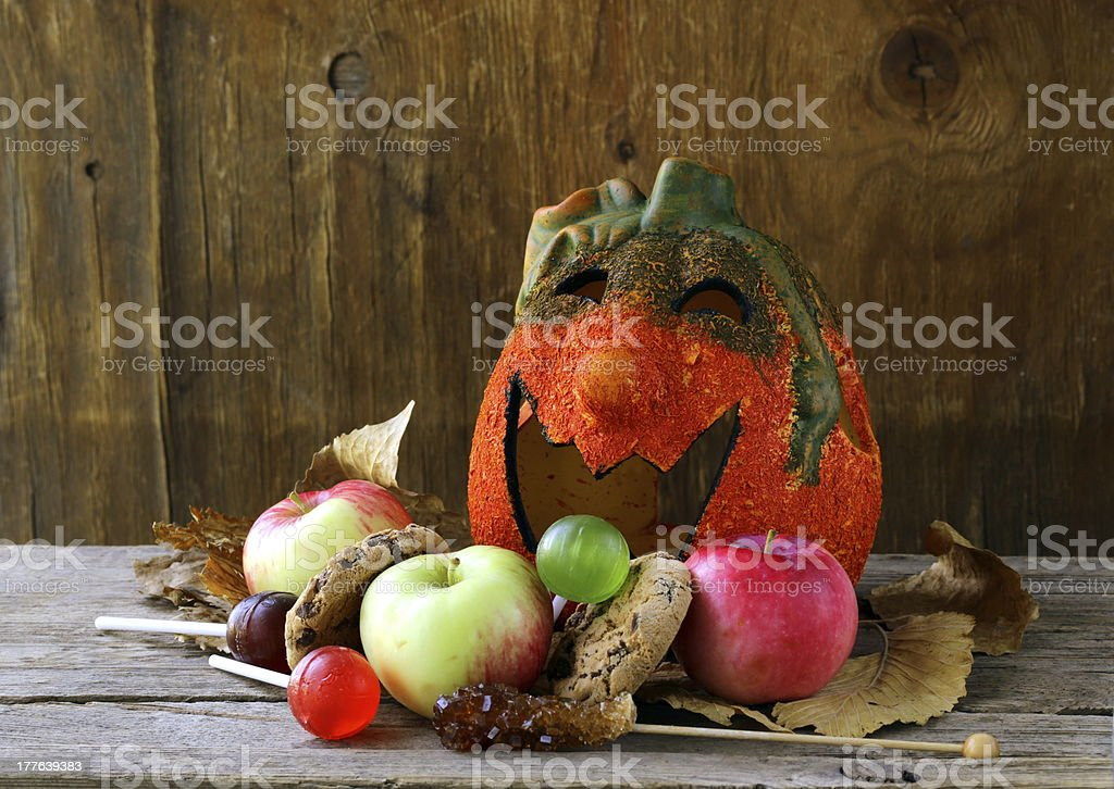 Halloween pumpkin Jack O'Lantern with fruit and sweets royalty-free stock photo
