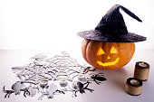 istock Halloween pumpkin on a white and gray background with candles and foggy smoke. Halloween holiday 1179102140