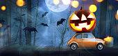 istock Halloween pumpkin on car 1040375984