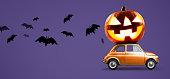 istock Halloween pumpkin on car 1040376022