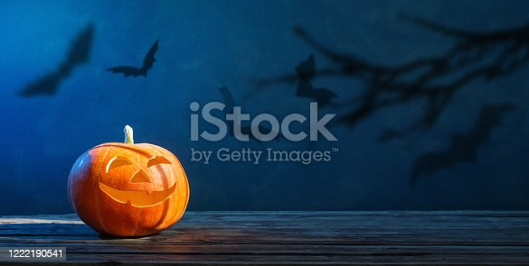 Halloween pumpkin on dark blue  background