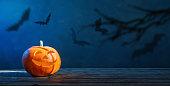 istock Halloween pumpkin on dark blue  background 1222190541