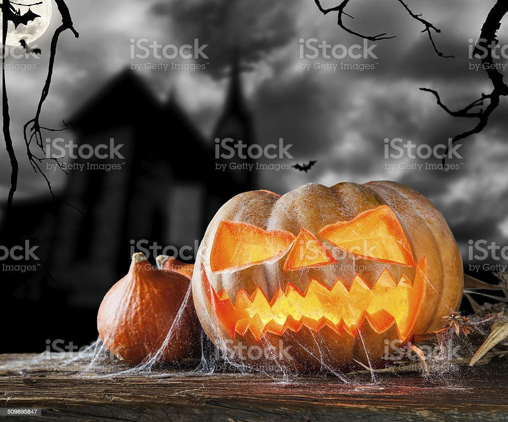 Halloween pumpkin on wood with dark background stock photo