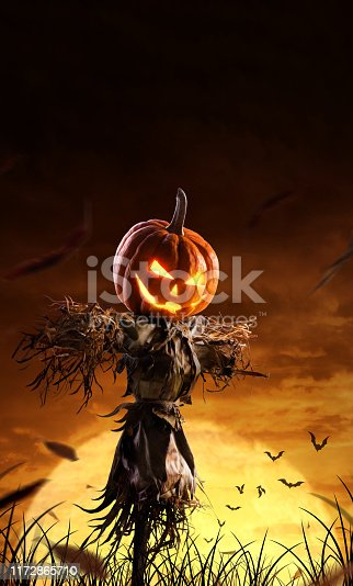 istock halloween pumpkin scarecrow on a wide field with the moon on a scary night 1172865710