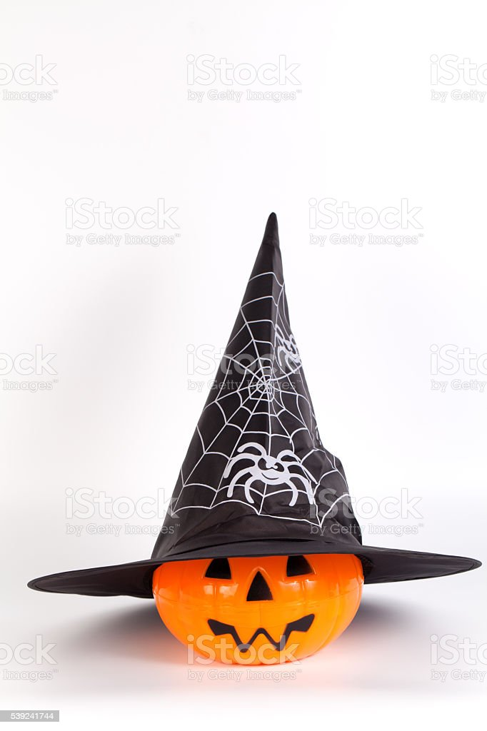 Halloween Pumpkin with Halloween hat with printed white spider royalty-free stock photo