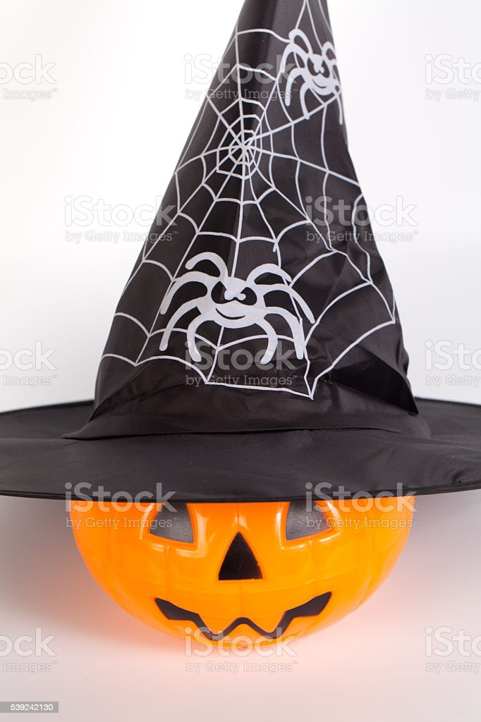Halloween Pumpkin with Halloween hat with printed white spider w royalty-free stock photo