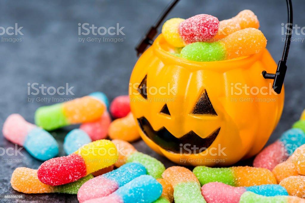 Halloween pumpkin with sweet candy stock photo