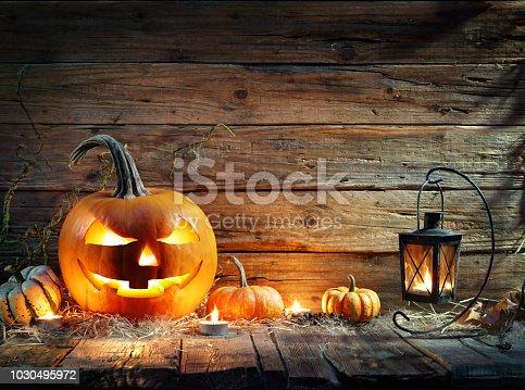Jack O' Lantern On Wooden Table With Lantern