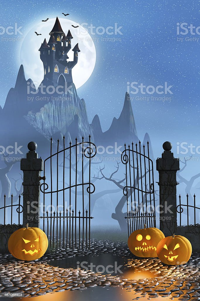 Halloween pumpkins next to a gate of a spooky castle royalty-free stock photo