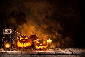 istock Halloween Pumpkins on old wooden table 854642656