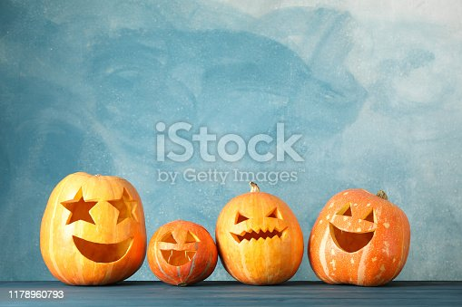 Halloween pumpkins on wooden background. Space for text