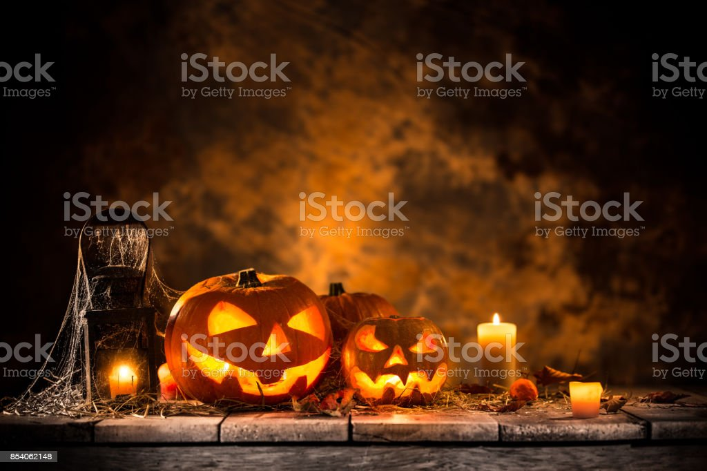 Halloween pumpkins on wooden planks stock photo