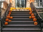 Halloween pumpkins in the entrance of a brownstone building in Brooklyn