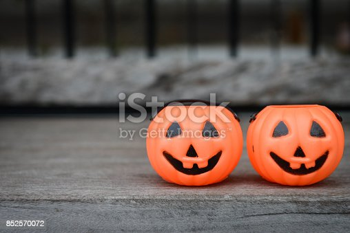 istock halloween pumpkins plastic for putting candy on thw wooden 852570072