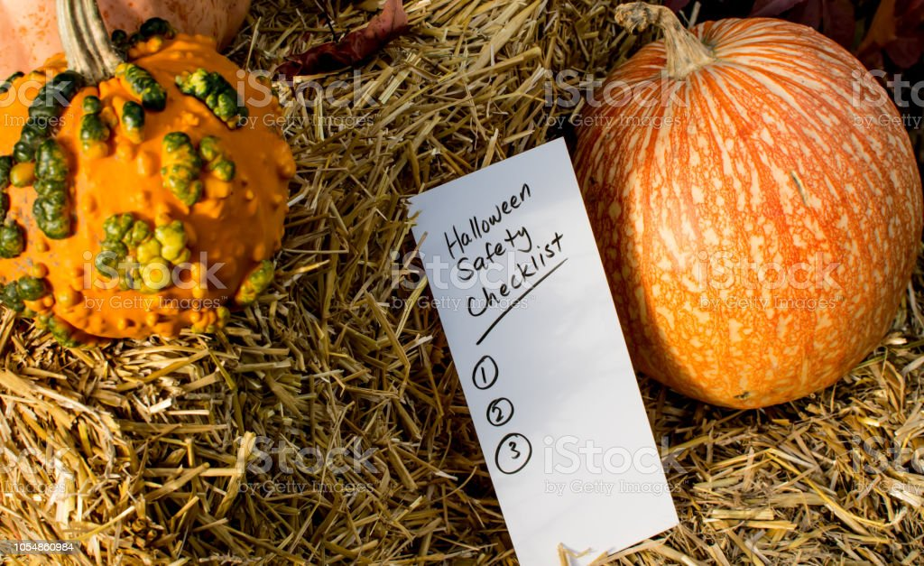 Halloween safety checklist with pumpkins on haystack stock photo