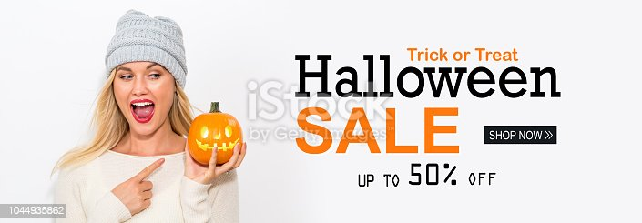 istock Halloween sale with woman holding a pumpkin 1044935862