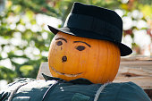 portrait of halloween scarecrow with pumpkin head