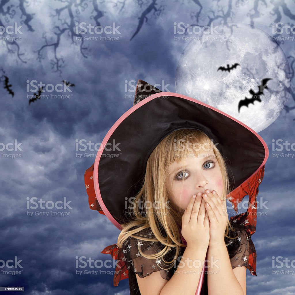 Halloween scared kid girl on dark moon sky royalty-free stock photo